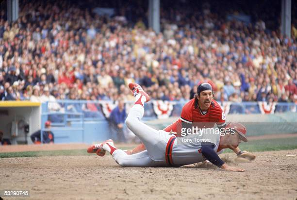Ray Fosse of the Cleveland Indians is involved in a play at the plate with Dwight Evans of the Boston Red Sox during an MLB game at Cleveland...