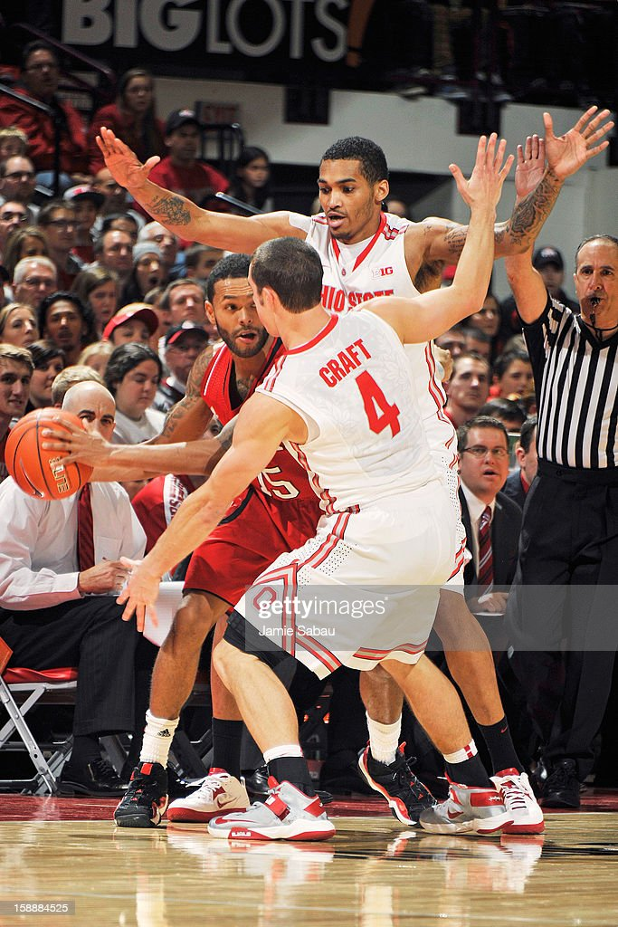 Ray Gallegos #15 of the Nebraska Cornhuskers looks for a teammate to pass to as Aaron Craft #4 of the Ohio State Buckeyes and LaQuinton Ross #10 of the Ohio State Buckeyes surround him with defensive pressure on January 2, 2013 at Value City Arena in Columbus, Ohio. Ohio State defeated Nebraska 70-44.
