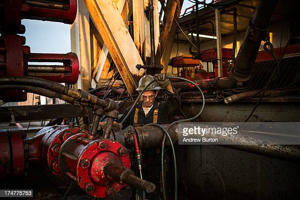 Ray Gerish a floor hand for Raven Drilling works on an oil rig drilling into the Bakken shale formation on July 28 2013 outside Watford City North...