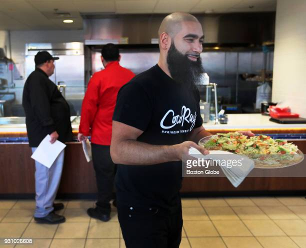 Ray Gonzalez proprietor of the mobile restaurant CocoRay's delivers a plate at the Revolving Test Kitchen in Lawrence MA on Jan 24 2018 The Lawrence...