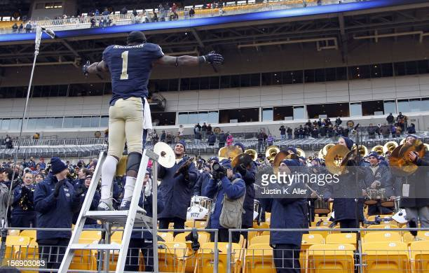 Ray Graham of the Pittsburgh Panthers directs the band after defeating the Scarlet Knights on November 24, 2012 at Heinz Field in Pittsburgh,...