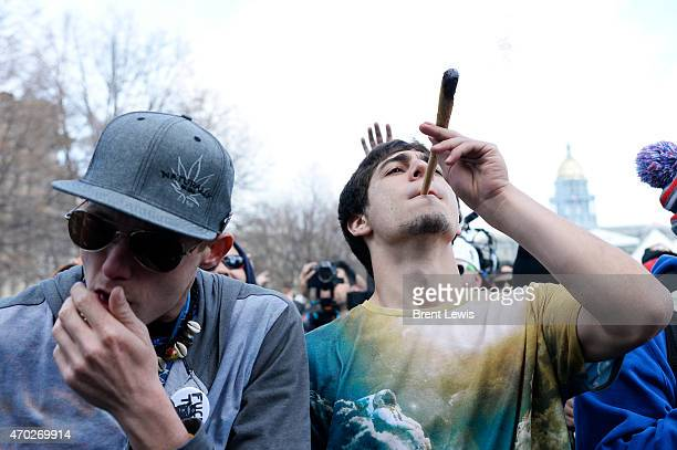 Ray Green smokes on a large joint on Saturday April 18 2015 at Civic Center Park in Denver Colorado The annual 420 Rally once again brought over a...