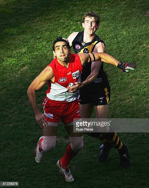 Ray Hall for the Tigers competes in the ruck against Adam Goodes for the Swans during the round twenty two AFL match between The Richmond Tigers and...