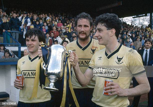 Ray Houghton , Billy Hamilton and John Aldridge of Oxford United holding the Football League Milk Cup trophy after the Oxford United v Arsenal...