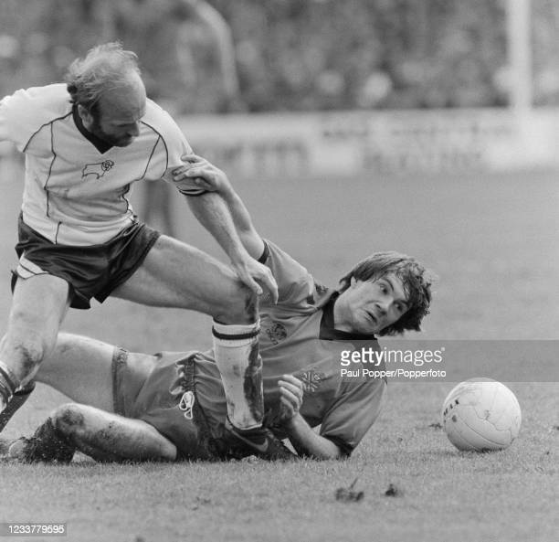 Ray Houghton of Fulham attempts to stop Archie Gemmill of Derby County during a Football League Division Two match at the Baseball Ground on May 14,...