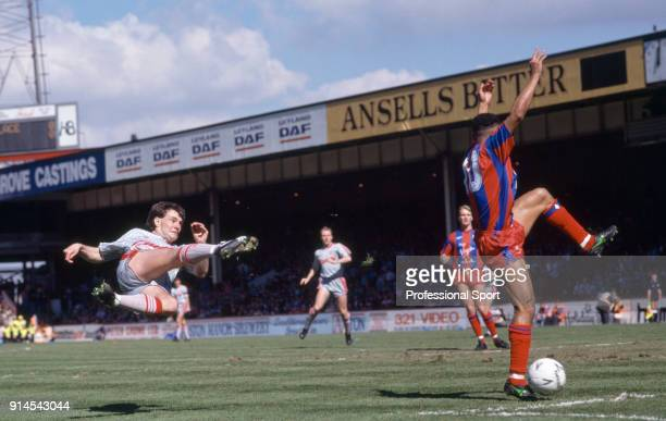 Ray Houghton of Liverpool shoots during the FA Cup Semi Final match between Crystal Palace and Liverpool at Villa Park on April 8, 1990 in...