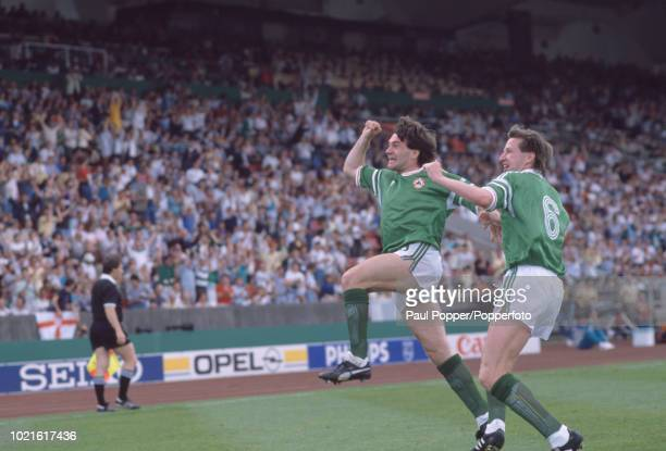 Ray Houghton of the Republic of Ireland celebrates after scoring with teammate Ronnie Whelan during the UEFA Euro 88 Group 2 match between England...