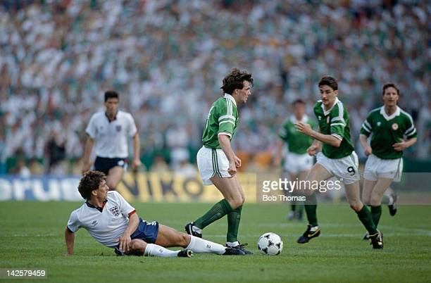 Ray Houghton of the Republic of Ireland moves past England's Kenny Sansom during the European Championship at Stuttgart 12th June 1988 The score was...