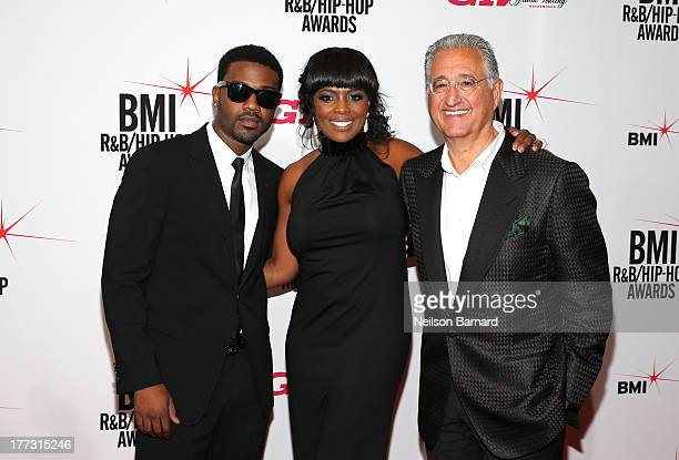 Ray J BMI Vice President Catherine Brewton and BMI President and CEO Del Bryant onstage at the 2013 BMI RB/HipHop Awards at Hammerstein Ballroom on...