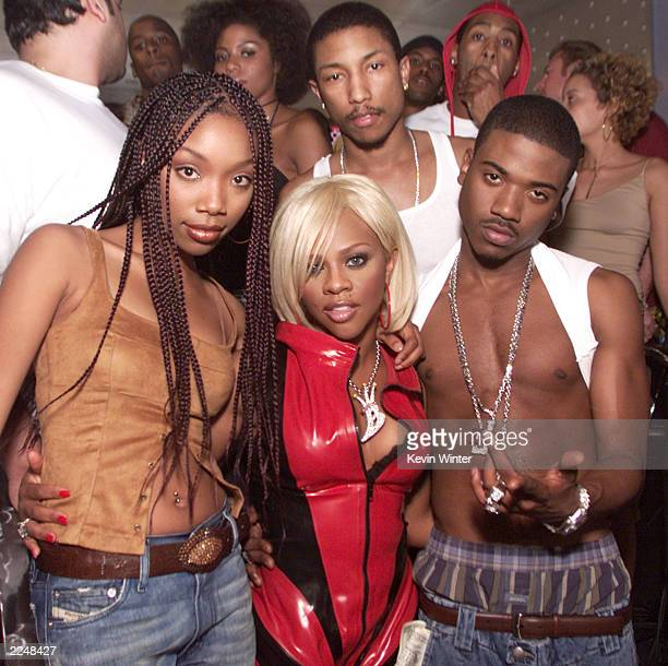 Ray J his sister Brandy Lil' Kim and Pharrell Williams producer and cowriter on the set of Ray J's new video 'Wait A Minute' featuring Lil' Kim his...