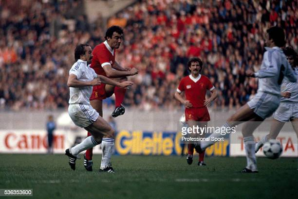 Ray Kennedy of Liverpool shoots despite a challenge from Uli Stielike of Real Madrid during the UEFA European Cup Final at the Parc des Princes in...