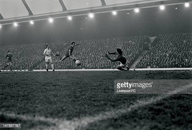 Ray Kennedy of Liverpool shoots towards Mervyn Day of West Ham United and his goal during the English First Division match between Liverpool and West...