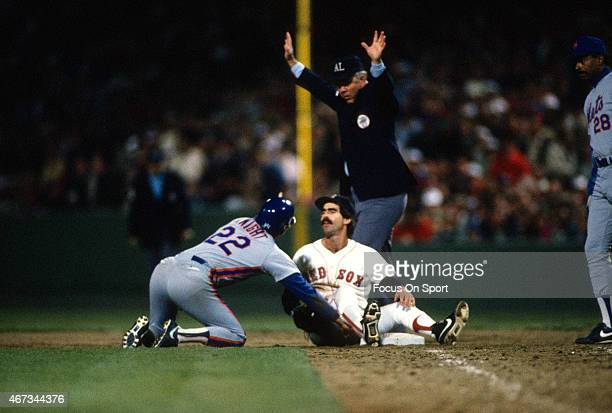 Ray Knight of the New York Mets is safe back at first base as Bill Buckner of the Boston Red Sox takes the throw over during the 1986 world series in...