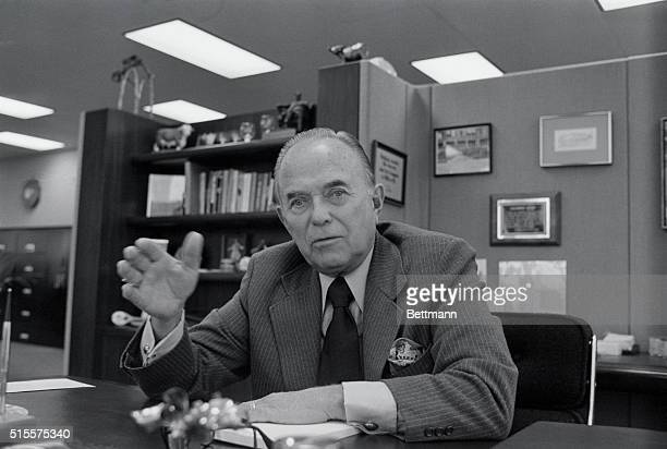 Ray Kroc Chairman of the Board of the McDonald's Corporation gestures as he sits at his desk at his company Chicago Illinois