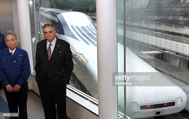 Ray LaHood US transportation secretary right and Yoshiyuki Kasai chairman of Central Japan Railway Co speak to the media after riding on a...