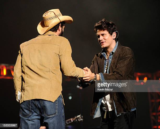 """Ray Lamontagne and John Mayer perform on stage during """"Love For Levon"""" Benefit To Save The Barn at Izod Center on October 3, 2012 in East Rutherford,..."""