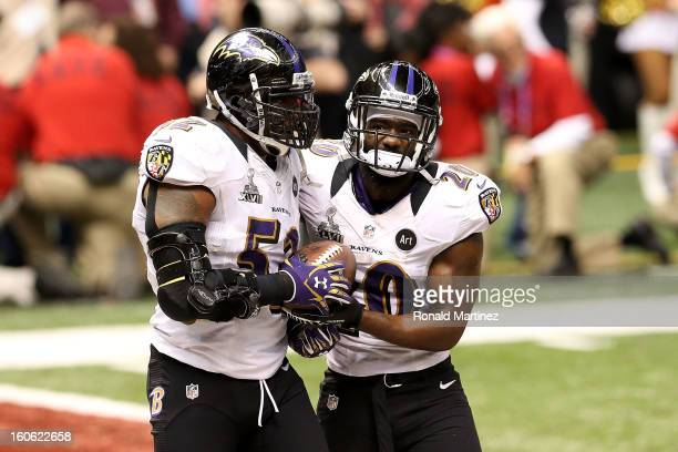 Ray Lewis and Ed Reed of the Baltimore Ravens react after the San Francisco 49ers couldn't convert on a fourth down play in the final two minutes of...