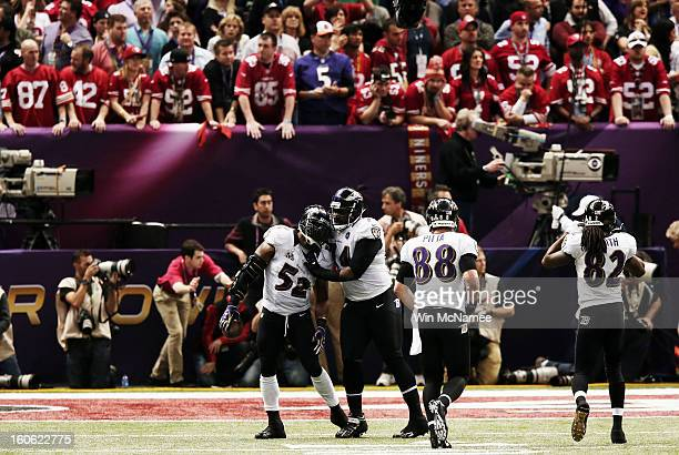 Ray Lewis and Michael Oher of the Baltimore Ravens celebrate after the San Francisco 49ers couldn't convert a fourth down play to turn the ball over...