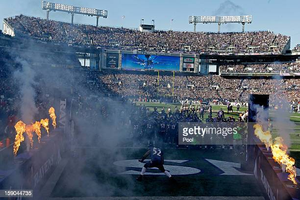 Ray Lewis of the Baltimore Ravens dances in front of his teammates on the field during player introductions against the Indianapolis Colts during the...