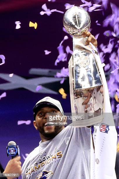 Ray Lewis of the Baltimore Ravens holds up the Vince Lombardi Trophy following their 3431 win against the San Francisco 49ers during Super Bowl XLVII...