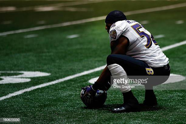 Ray Lewis of the Baltimore Ravens kneels down during a power outage that occurred in the third quarter and caused a 34minute delay during Super Bowl...