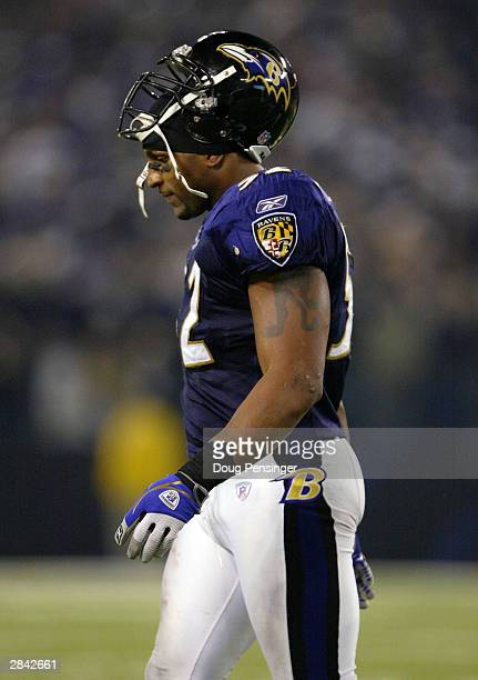 Ray Lewis of the Baltimore Ravens leaves the field dejected after Gary Anderson of the Tennessee Titans kicked a 46yard gamewinning field goal in the...