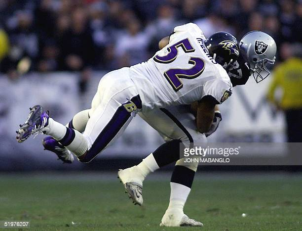 Ray Lewis of the Baltimore Ravens tackles Jeremy Brigham of the Oakland Raiders during their AFC Championship game 14 January 2001 at the Network...