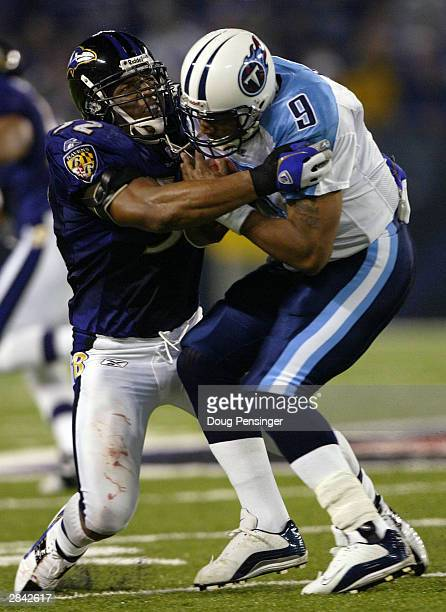 Ray Lewis of the Baltimore Ravens tackles Steve McNair of the Tennessee Titans during AFC WildCard playoff action on January 3 2004 at the MT Bank...