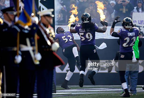 Ray Lewis of the Baltimore Ravens takes the field with teammates Dannell Ellerbe and Jimmy Smith against the Indianapolis Colts during the AFC Wild...