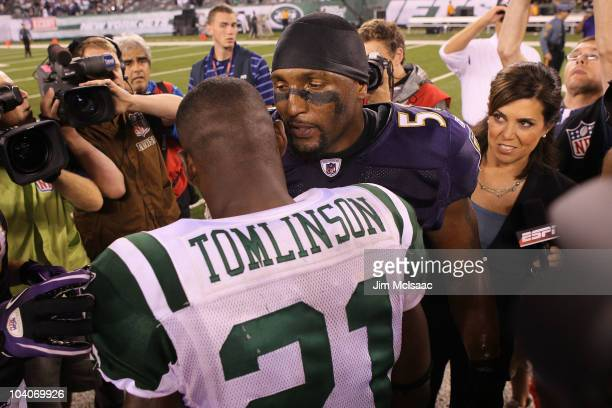 Ray Lewis of the Baltimore Ravens talks to LaDainian Tomlinson of the New York Jets after defeating the New York Jets in their home opener at the New...