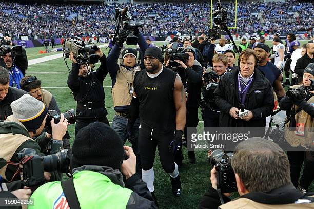 Ray Lewis of the Baltimore Ravens walks around the field after the Ravens won 249 against the Indianapolis Colts during the AFC Wild Card Playoff...