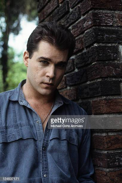 Ray Liotta leaning against brick column in a scene from the film 'Dominick And Eugene' 1988