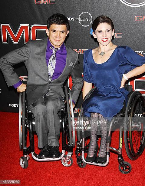 Ray Martina and athlete Amanda McGrory arrive at the BODY at ESPYS PreParty held at Lure on July 15 2014 in Hollywood California