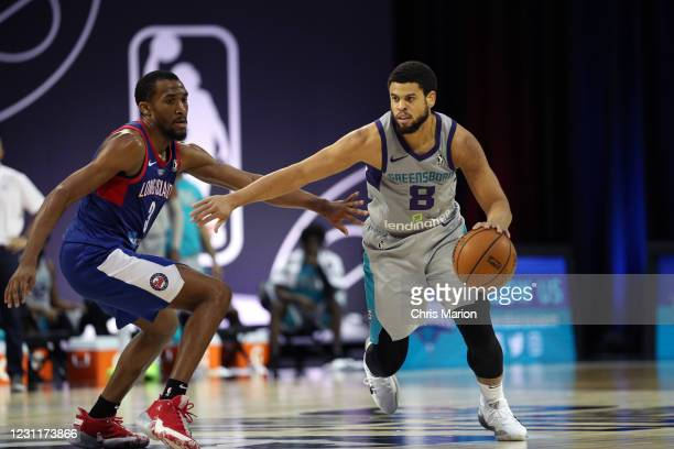 Ray McCallum of the Greensboro Swarm drives to the basket against the Long Island Nets on February 14, 2021 at HP Field House in Orlando, Florida....