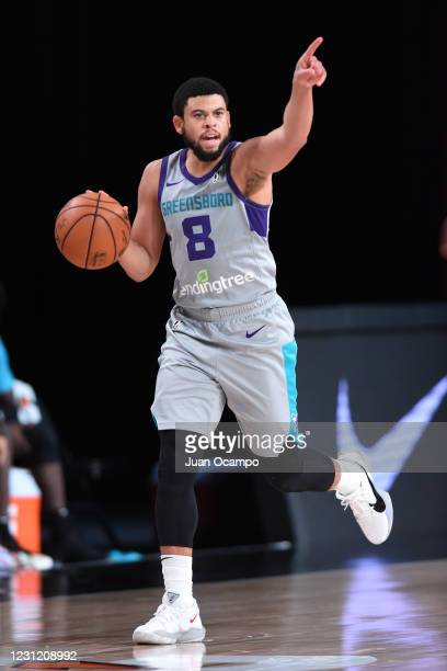 Ray McCallum of the Greensboro Swarm handles the ball against the Delaware Blue Coats on February 16, 2021 at AdventHealth Arena in Orlando, Florida....