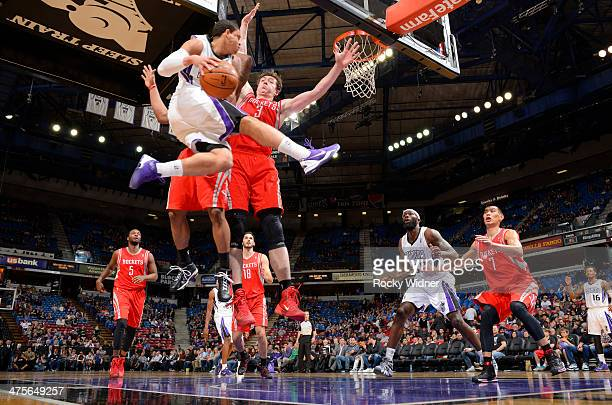 Ray McCallum of the Sacramento Kings passes against Omer Asik of the Houston Rockets on February 25 2014 at Sleep Train Arena in Sacramento...