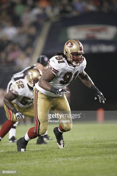 Ray McDonald of the San Francisco 49ers defends during the NFL game against the Chicago Bears at Soldier Field on August 21 2008 in Chicago Illinois...