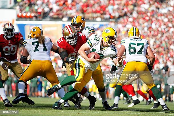 Ray McDonald of the San Francisco 49ers pressure Aaron Rodgers of the Green Bay Packers during the game at Candlestick Park on September 8 2013 in...