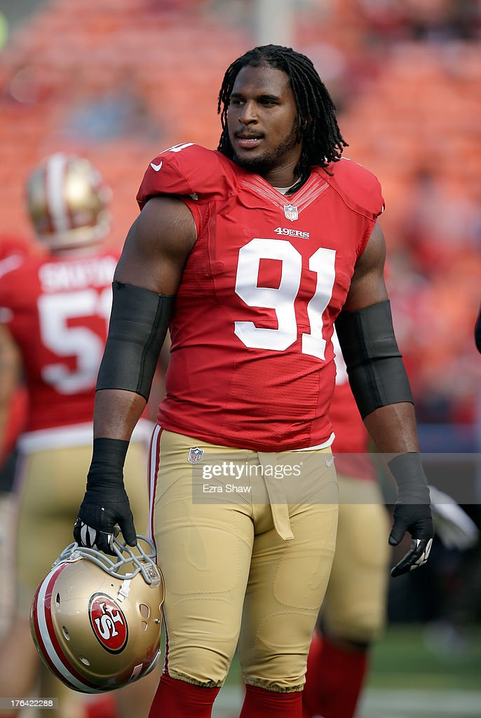 Ray McDonald #91 of the San Francisco 49ers stands on the field before their game against the Denver Broncos at Candlestick Park on August 8, 2013 in San Francisco, California.