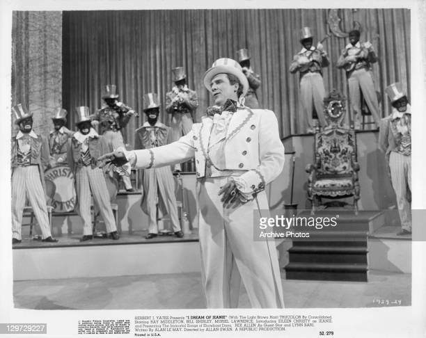 Ray Middleton performs on stage in a scene from the film 'I Dream Of Jeanie' 1952