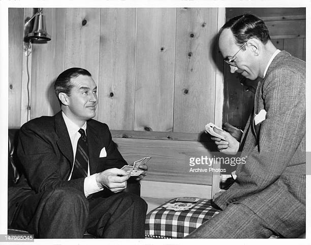 Ray Milland and Doug Spencer enjoying a game of cards in between scenes from the film 'A Life Of Her Own' 1950