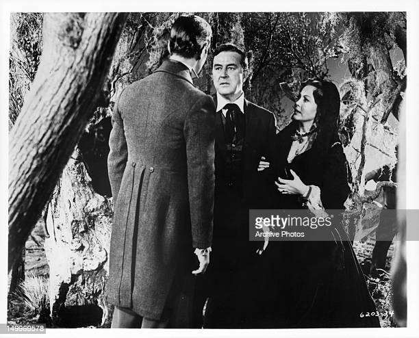 Ray Milland and Hazel Court talking with man outside in a scene from the film 'Premature Burial' 1962