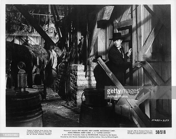 Ray Milland in dark horse stable in a scene from the film 'Copper Canyon' 1950