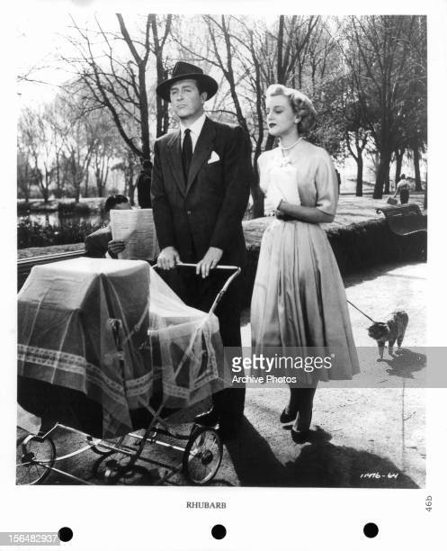 Ray Milland pushes a stroller with Jan Sterling in a scene from the film 'Rhubarb', 1951.