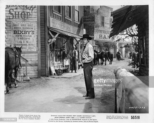 Ray Milland turning to his left in a scene from the film 'Copper Canyon' 1950