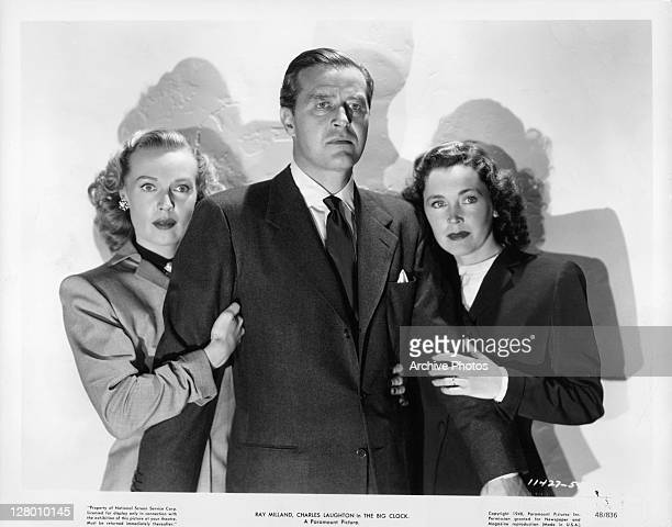 Ray Milland with two actresses in a scene from the film 'The Big Clock' 1948