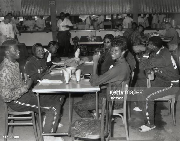 Ray Morton and Wilma Rudolph are shown with others in the International Restaurant at the Olympic Village
