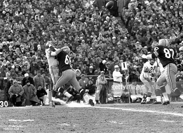 Ray Nitschke of the Green Bay Packers goes for the sack of quarterback YA Tittle of the New York Giants during the 1961 NFL Championship game at the...