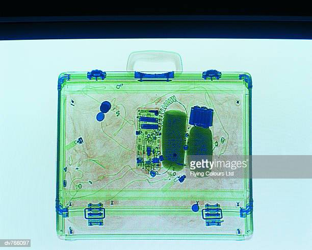x ray of a suitcase showing a bomb - terrorism stock pictures, royalty-free photos & images
