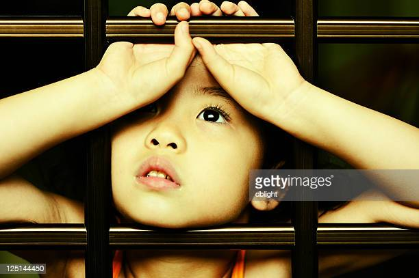 ray of hope - child behind bars stock pictures, royalty-free photos & images